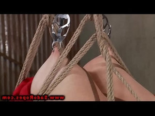 Hogtied bdsm whore gets clamp in her mouth