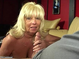 Busty amateur blonde babe gives head while smoking