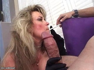 Sexy amateur blonde mature smokes and sucks a nice cock